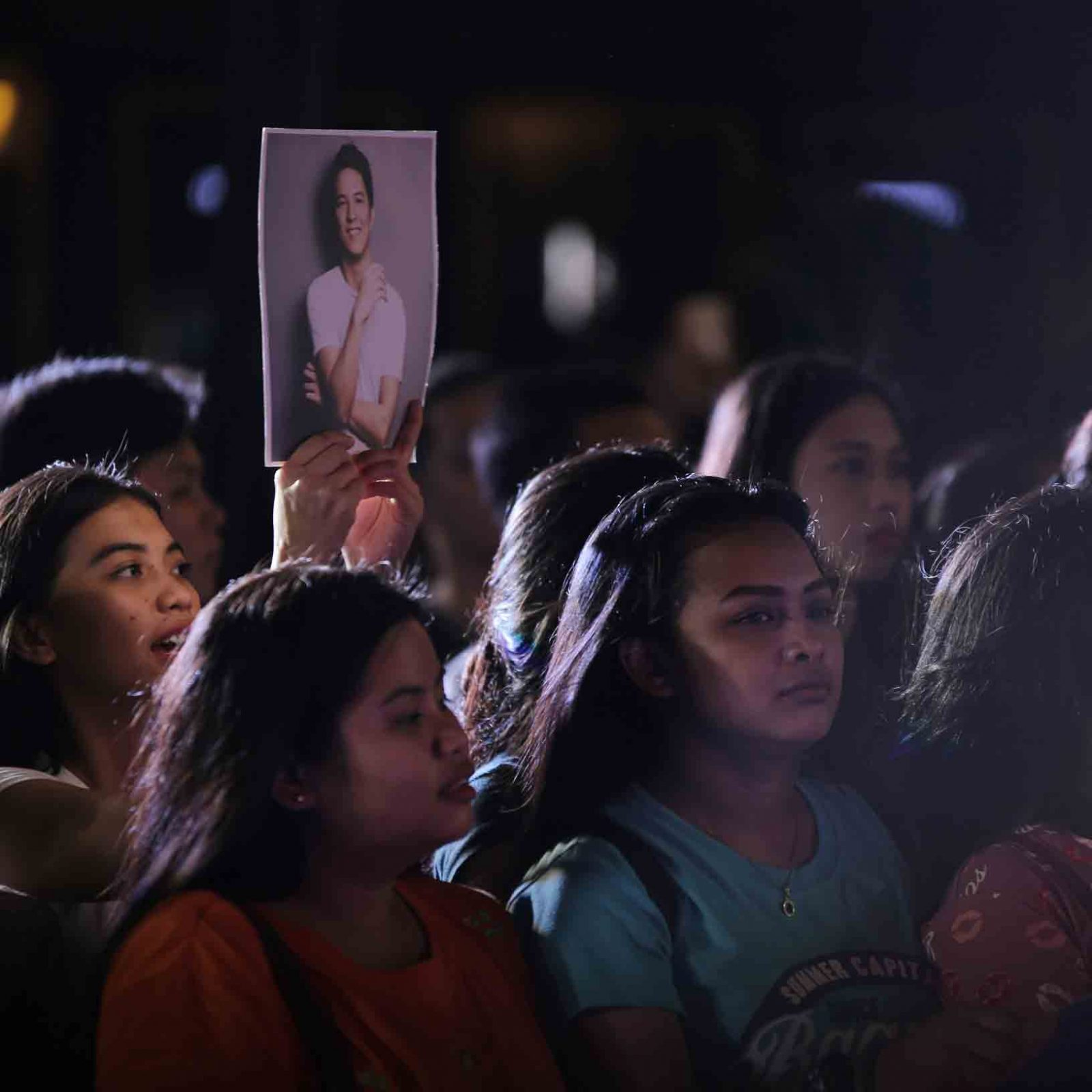 As TJ Monterde couples KZ Tandingan with their much-requested collaboration, one of his fans holds his photo up in support of her musical idol.   (Photo courtesy of Photoville International)