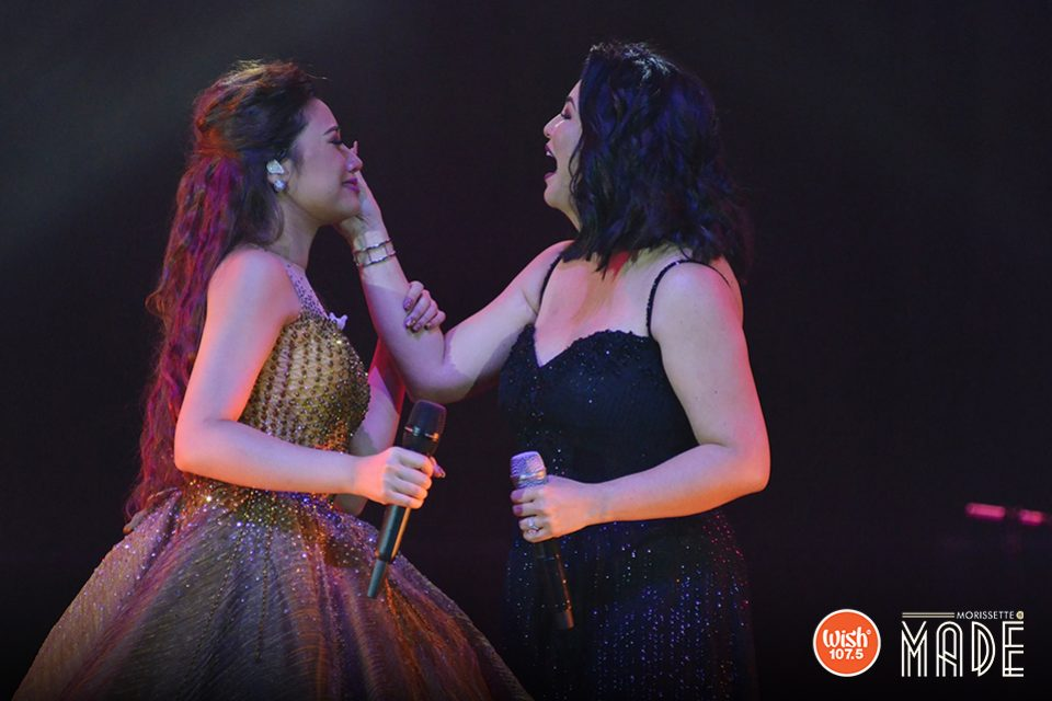 Asia's Songbird Regine Velasquez-Alcasid fondles a tearful Morissette right after their duet, as the latter clings lovingly to her idol for the privilege of sharing the spotlight.