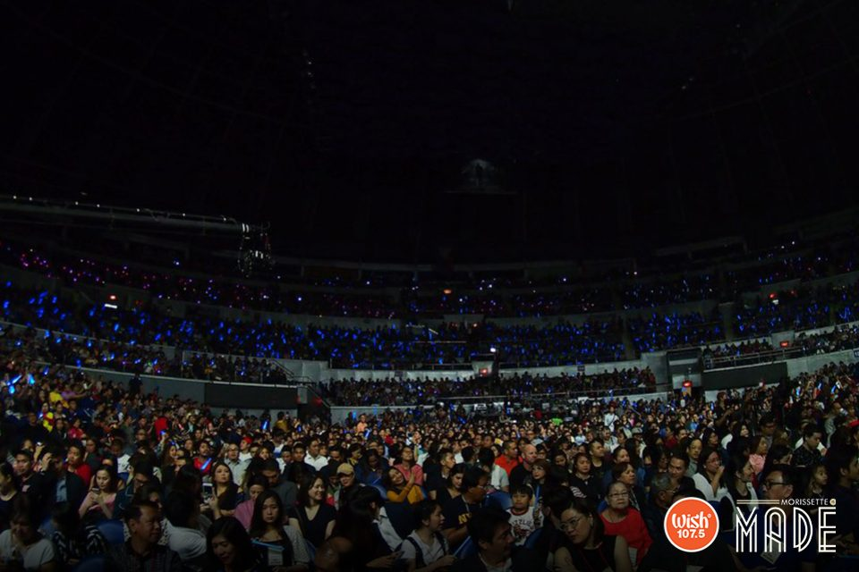 Inside the Big Dome, Morissette's thousands of fans and supporters fill up the seats as they eagerly await her performance.