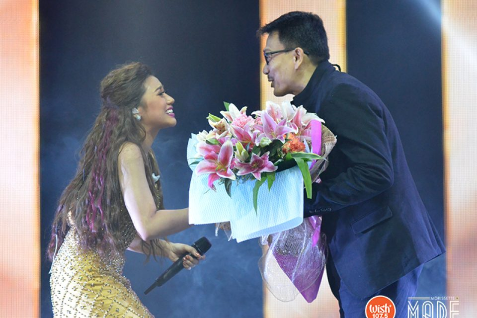 Mr. Daniel Razon, better known as Kuya Daniel, shares a warm, brotherly hug with Morissette as he hands the singer a bouquet of flowers.