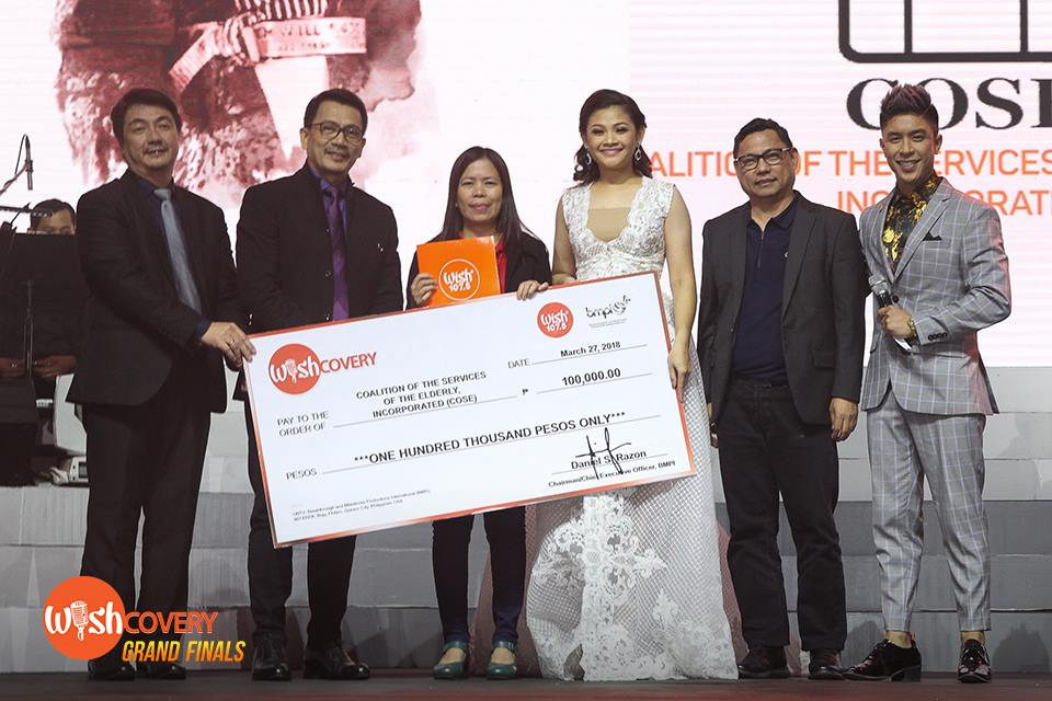 (L-R) BMPI VP for Radio Mr. Gerardo Etorma III, BMPI President and CEO Kuya Daniel Razon, Coalition of the Services of the Elderly, Inc. representative, Wishcovery 2nd Runner Up Louie Anne Culala, VP for TV and Marketing Mr. Jay Eusebio, and Wishcovery host Kris Lawrence pose for a photo after presenting the P100,000 donation to Louie Anne's chosen charity.