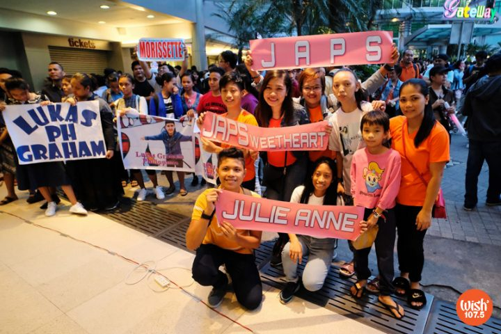 """Young fans of Julie Anne San Jose pose for a snapshot with their banners bearing the talented artist's nickname """"Japs"""". Supporters of international singer Lukas Graham and local artist Morissette Amon also share the frame as they await their music icons."""